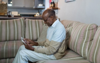 senior man using tablet to read about his vascular and arterial health